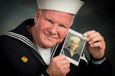"""<div class=""""source"""">Submitted</div><div class=""""image-desc"""">Gary Vidito poses with a photo of his father, Jewel Marcus Vidito. Gary tells of his father's experiences in WWII, and performs songs of the period.</div><div class=""""buy-pic""""></div>"""