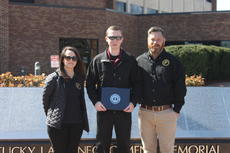 "<div class=""source"">Submitted</div><div class=""image-desc"">Nelson County E-911 Dispatchers at the Kentucky Law Enforcement Memorial. From left, Dispatcher Donna Shehan, Dispatcher Austin Hale, Director Milt Spalding. </div><div class=""buy-pic""></div>"