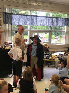 "<div class=""source"">Submitted Photo</div><div class=""image-desc"">The third and fourth graders at St. Gregory School recently participated in a ""Pioneer Day."" Visitors included Steve Morris, a former teacher at the school and a living history actor, who dressed as a long hunter and brought in artifacts to teach students about these early explorers of Kentucky. From left are Dominic Willis, Morris and Landon McCarty dressed in historical clothing. </div><div class=""buy-pic""></div>"