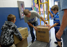 "<div class=""source"">KACIE GOODE/The Kentucky Standard</div><div class=""image-desc"">Students assist Jeremey Booher in loading boxes of supplies to be sent to different schools in Texas. Cox's Creek Elementary students helped organize the drive, a collaboration with other schools in the area, for a project-based learning assignment.</div><div class=""buy-pic""><a href=""/photo_select/89671"">Buy this photo</a></div>"