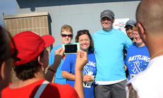 """<div class=""""source"""">KACIE GOODE/The Kentucky Standard</div><div class=""""image-desc"""">Randy Pinkston, center, poses for photos with friends and family after the annual Labor Day 5K/10K event at Nelson County High School. Proceeds from this year's race benefited Pinkston, who has been battling cancer.</div><div class=""""buy-pic""""><a href=""""/photo_select/79272"""">Buy this photo</a></div>"""