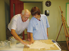 """<div class=""""source"""">Photo Submitted</div><div class=""""image-desc"""">Carter Lasure, along with BCA student Cameron Passanisi, do sticky work as they apply the gooey mixture of flour, salt and water to the outline of Brazil.</div><div class=""""buy-pic""""></div>"""