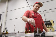 """<div class=""""source"""">KACIE GOODE/The Kentucky Standard</div><div class=""""image-desc"""">Joey Gary, a newer participant of the Guthrie Opportunity Center, said he is enjoying his new job at the bottling line, established through ReBart Bottling Company, whos co-owner is a board member of the center's foundation.</div><div class=""""buy-pic""""><a href=""""/photo_select/83394"""">Buy this photo</a></div>"""