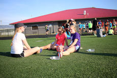 """<div class=""""source"""">KACIE GOODE/The Kentucky Standard</div><div class=""""image-desc"""">Runner rest on the football field Monday at the Labor Day race event at Nelson County High School.</div><div class=""""buy-pic""""><a href=""""/photo_select/79273"""">Buy this photo</a></div>"""