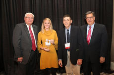 "<div class=""source"">Submitted Photo</div><div class=""image-desc"">Leah Pottinger of Nelson County and James Monin, president, Nelson County Farm Bureau, accept the Gold Star Award of Excellence from Mark Haney, Kentucky Farm Bureau president, and David S. Beck, executive vice president.</div><div class=""buy-pic""></div>"