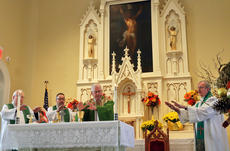"""<div class=""""source"""">KACIE GOODE/The Kentucky Standard</div><div class=""""image-desc"""">Those leading services Sunday prepare for communion at St. Michaels in Fairfield. The Catholic church celebrated 225 years.</div><div class=""""buy-pic""""><a href=""""/photo_select/89757"""">Buy this photo</a></div>"""