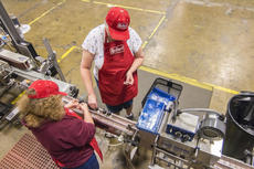 """<div class=""""source"""">KACIE GOODE/The Kentucky Standard</div><div class=""""image-desc"""">Diane Shields and Hazel Cothern both enjoy working on seals at the new bottling line station at Guthrie Opportunity Center. The line, established by ReBart Bottling Company, provides new and different jobs for participants of the center. Hazel said one of her goals is to build the appropriate work skills to gain a job out in the community.</div><div class=""""buy-pic""""><a href=""""/photo_select/83384"""">Buy this photo</a></div>"""