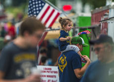 "<div class=""source"">KACIE GOODE/The Kentucky Standard</div><div class=""image-desc"">Brinley Tanksley sits on John Tanksley's shoulders while they wait in line Saturday during the Rolling Fork Iron Horse Festival in New Haven.</div><div class=""buy-pic""><a href=""/photo_select/98054"">Buy this photo</a></div>"