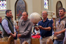 """<div class=""""source"""">KACIE GOODE/The Kentucky Standard</div><div class=""""image-desc"""">Grounds staff at Nazareth carry in the globe Friday during the annual Earth Day event at St. Vincent Church.</div><div class=""""buy-pic""""><a href=""""/photo_select/94622"""">Buy this photo</a></div>"""