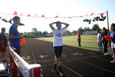 """<div class=""""source"""">KACIE GOODE/The Kentucky Standard</div><div class=""""image-desc"""">Runner Jackson Boone catches his breath after crossing the finish line Monday. Boone finished the 5K with a time of 19:15:03.</div><div class=""""buy-pic""""><a href=""""/photo_select/79263"""">Buy this photo</a></div>"""