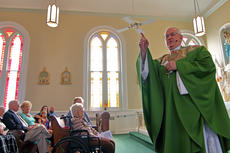 """<div class=""""source"""">KACIE GOODE/The Kentucky Standard</div><div class=""""image-desc"""">Archbishop Joseph E. Kurtz speaks to the congregation Sunday while a guest at St. Michaels in Fairfield. The Catholic church recently celebrated 225 years.</div><div class=""""buy-pic""""><a href=""""/photo_select/89742"""">Buy this photo</a></div>"""