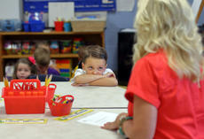 "<div class=""source"">KACIE GOODE/The Kentucky Standard</div><div class=""image-desc"">Reece Unseld leans closer as his new kindergarten teacher explains the class rules Tuesday on the first day of school. Bardstown Independent Schools returned from summer break Tuesday and several parochial schools return today.</div><div class=""buy-pic""><a href=""/photo_select/88059"">Buy this photo</a></div>"