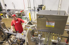 """<div class=""""source"""">KACIE GOODE/The Kentucky Standard</div><div class=""""image-desc"""">Joey Gary, a newer participant of the Guthrie Opportunity Center, said he is enjoying his new job at the bottling line, established through ReBart Bottling Company, whos co-owner is a board member of the center's foundation.</div><div class=""""buy-pic""""><a href=""""/photo_select/83385"""">Buy this photo</a></div>"""