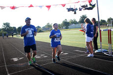 """<div class=""""source"""">KACIE GOODE/The Kentucky Standard</div><div class=""""image-desc"""">Bruce and Lily Smith cross the finish line  together Monday at the annual Labor Day race event at Nelson County High School.</div><div class=""""buy-pic""""><a href=""""/photo_select/79264"""">Buy this photo</a></div>"""