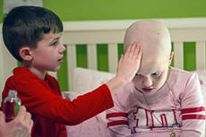 """<div class=""""source"""">KACIE GOODE/The Kentucky Standard</div><div class=""""image-desc"""">Little brother Jeffrey touches his sister's head with holy water during a bedtime ritual as the Hughes family prays for 9-year-old Alexa's recovery from ovarian cancer.</div><div class=""""buy-pic""""><a href=""""/photo_select/83894"""">Buy this photo</a></div>"""