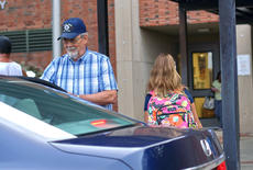 "<div class=""source"">KACIE GOODE/The Kentucky Standard</div><div class=""image-desc"">""Papa Joe"" Nalley opens car doors and greets kids on the first day of school Tuesday at Bardstown Elementary. The volunteer has been helping out for the past four years.</div><div class=""buy-pic""><a href=""/photo_select/88058"">Buy this photo</a></div>"