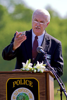 "<div class=""source"">KACIE GOODE/The Kentucky Standard</div><div class=""image-desc"">Rev. Tom Mobley speaks at a memorial Friday morning for Bardstown Police Officer Jason Ellis, who was murdered five years ago on May 25, 2013.</div><div class=""buy-pic""><a href=""/photo_select/95628"">Buy this photo</a></div>"
