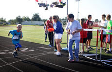 """<div class=""""source"""">KACIE GOODE/The Kentucky Standard</div><div class=""""image-desc"""">Owen McDowell gets some encouragement as he crosses the finish line Monday at the annual Labor Day race event at Nelson County High School.</div><div class=""""buy-pic""""><a href=""""/photo_select/79265"""">Buy this photo</a></div>"""
