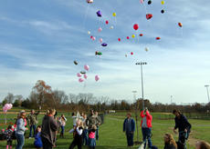 """<div class=""""source"""">KACIE GOODE/The Kentucky Standard</div><div class=""""image-desc"""">Colorful balloons float upward Saturday as friends and family of Amber Tingle and Billie Rose Watts remember them and celebrate their lives. The two young women were killed in a crash in August.</div><div class=""""buy-pic""""><a href=""""/photo_select/90904"""">Buy this photo</a></div>"""