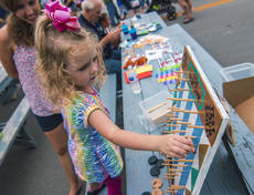 "<div class=""source"">KACIE GOODE/The Kentucky Standard</div><div class=""image-desc"">Lillian Ball, 3, plays a disk drop game Saturday during the Iron Horse Festival in New Haven. The Rolling Fork Baptist Church offered activities for kids at its festival booth.</div><div class=""buy-pic""><a href=""/photo_select/98057"">Buy this photo</a></div>"