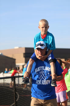 """<div class=""""source"""">KACIE GOODE/The Kentucky Standard</div><div class=""""image-desc"""">Owen McDowell rides on Jeff Ballard's shoulders Monday after the annual Labor Day race event at Nelson County High School.</div><div class=""""buy-pic""""><a href=""""/photo_select/79266"""">Buy this photo</a></div>"""