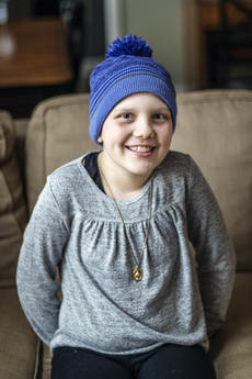 """<div class=""""source"""">KACIE GOODE/The Kentucky Standard</div><div class=""""image-desc"""">Alexa Hughes sits inside her Bardstown home, a place she has seen a lot of lately as she battles stage four ovarian cancer.</div><div class=""""buy-pic""""><a href=""""/photo_select/83988"""">Buy this photo</a></div>"""