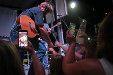 """<div class=""""source"""">KACIE GOODE/The Kentucky Standard </div><div class=""""image-desc"""">Headliner Glen Templeton interacts with the crowd Saturday during the Bourbon City Street Concert. </div><div class=""""buy-pic""""><a href=""""/photo_select/77633"""">Buy this photo</a></div>"""