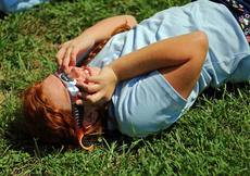 "<div class=""source"">KACIE GOODE/The Kentucky Standard</div><div class=""image-desc"">Audrey Greenwell relaxes on the ground as she views the eclipse Monday at St. Gregory School.</div><div class=""buy-pic""><a href=""/photo_select/88607"">Buy this photo</a></div>"