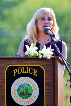 "<div class=""source"">KACIE GOODE/The Kentucky Standard</div><div class=""image-desc"">Heidi Baldwin sings ""Amazing Grace"" during a memorial service Friday morning for Bardstown Police Officer Jason Ellis, who was murdered five years ago on May 25, 2013.</div><div class=""buy-pic""><a href=""/photo_select/95630"">Buy this photo</a></div>"