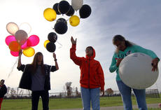 """<div class=""""source"""">KACIE GOODE/The Kentucky Standard</div><div class=""""image-desc"""">Two of Amber Tingle's little brothers release balloons Saturday in honor of their sister and her friend, Billie Rose Watts. At right, mom Tina writes on a balloon before releasing it. The balloon release was held at Dean Watts Park for the two young women killed in a collision in August in front of Flaget Memorial Hospital.</div><div class=""""buy-pic""""><a href=""""/photo_select/90905"""">Buy this photo</a></div>"""