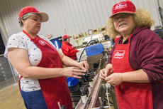 """<div class=""""source"""">KACIE GOODE/The Kentucky Standard</div><div class=""""image-desc"""">Diane Shields and Hazel Cothern both enjoy working on seals at the new bottling line station at Guthrie Opportunity Center. The line, established by ReBart Bottling Company, provides new and different jobs for participants of the center. In the background is Erica Goode.</div><div class=""""buy-pic""""><a href=""""/photo_select/83388"""">Buy this photo</a></div>"""