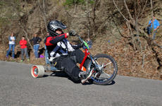"<div class=""source"">KACIE GOODE/The Kentucky Standard</div><div class=""image-desc"">A racer flies down Cissal Hill Road Sunday afternoon while taking part in the annual Big Wheel Race.</div><div class=""buy-pic""><a href=""/photo_select/91226"">Buy this photo</a></div>"
