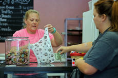 "<div class=""source"">KACIE GOODE/The Kentucky Standard</div><div class=""image-desc"">A customer buys a bundle of dog treats Friday while stopping by Just Barked during the dog bakery and boutique's grand opening.</div><div class=""buy-pic""><a href=""/photo_select/88749"">Buy this photo</a></div>"
