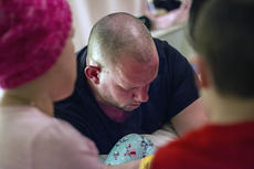 """<div class=""""source"""">KACIE GOODE/The Kentucky Standard</div><div class=""""image-desc"""">Ben Hughes prays over his daughter Alexa, joined by his wife and two sons. It's become a nightly ritual as Alexa battles ovarian cancer.</div><div class=""""buy-pic""""><a href=""""/photo_select/83900"""">Buy this photo</a></div>"""