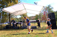 """<div class=""""source"""">KACIE GOODE/The Kentucky Standard</div><div class=""""image-desc"""">Children dance while a band plays in the entertainment area of ColorFest, Bernheim's annual fall celebration.</div><div class=""""buy-pic""""><a href=""""/photo_select/80421"""">Buy this photo</a></div>"""