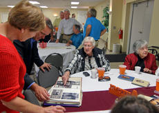 """<div class=""""source"""">KACIE GOODE/The Kentucky Standard</div><div class=""""image-desc"""">Members of the Simpson family and friends flipped through albums of old photographs Sunday afternoon following the 225th anniversary of St. Michael&'s in Fairfield.</div><div class=""""buy-pic""""><a href=""""/photo_select/89749"""">Buy this photo</a></div>"""