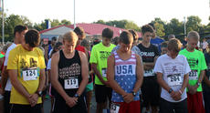 """<div class=""""source"""">KACIE GOODE/The Kentucky Standard</div><div class=""""image-desc"""">Runners bow their heads for prayer Monday morning at the start of the annual Labor Day 5K/10K event at Nelson County High School. This year's race benefited a local teacher and coach battling cancer.</div><div class=""""buy-pic""""><a href=""""/photo_select/79271"""">Buy this photo</a></div>"""