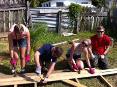 "<div class=""source"">PHOTO SUBMITTED</div><div class=""image-desc"">Alexandria Mills, Frank Hibbs, Anna Hibbs and Jonathan Hibbs work together to make 3-inch siding for a home in Belize City.</div><div class=""buy-pic""></div>"