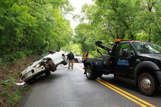 """<div class=""""source"""">ERIN L. MCCOY/The Kentucky Standard</div><div class=""""image-desc"""">A Camaro that landed on its hood next to Loretto Road is flipped back over by Coulter's Towing Friday afternoon. The driver, Francis S. Clark, 28, of St. Francis, was not injured. </div><div class=""""buy-pic""""><a href=""""/photo_select/26146"""">Buy this photo</a></div>"""