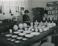 """<div class=""""source"""">Photo submitted</div><div class=""""image-desc"""">Jeannette helped make glaze for the pottery Jim fired in a kiln he built at Spalding Hall. </div><div class=""""buy-pic""""></div>"""
