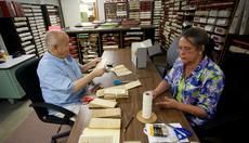 """<div class=""""source"""">FORREST BERKSHIRE/The Kentucky Standard</div><div class=""""image-desc"""">Josh Brands and Mary Ellen Moore work in the basement of the Nelson County Clerk's office preserving documents dating back more than two centuries. </div><div class=""""buy-pic""""><a href=""""/photo_select/48027"""">Buy this photo</a></div>"""