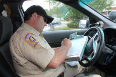 "<div class=""source"">RANDY PATRICK/The Kentucky Standard</div><div class=""image-desc"">Nelson County Deputy Sheriff Jerry Hardin writes a ticket for a driver who wasn&#039;t wearing his seat belt, nor was his passenger. Hardin this week was honored by the Office of Highway Safety for writing the most tickets for the violation of any officer in his district, 241.</div><div class=""buy-pic""><a href=""/photo_select/88704"">Buy this photo</a></div>"