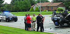 "<div class=""source"">RANDY PATRICK/The Kentucky Standard</div><div class=""image-desc"">Bardstown Police Sgts. Andrew Riley and Michael Medley and Deputy Sheriff Jamie Ferrie talk about the three-car crash with two other men.</div><div class=""buy-pic""><a href=""/photo_select/88340"">Buy this photo</a></div>"