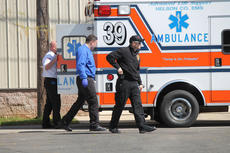 "<div class=""source"">RANDY PATRICK/The Kentucky Standard</div><div class=""image-desc"">Two ambulances were in an alleyway behind Cash Express after a shooting Tuesday afternoon, but police would only confirm that one victim was wounded by gunfire. The first call came in at 3:22 p.m.</div><div class=""buy-pic""><a href=""/photo_select/74888"">Buy this photo</a></div>"