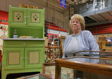 """<div class=""""source"""">KACIE GOODE/The Kentucky Standard</div><div class=""""image-desc"""">Barbara Sharp, of Hendersonville, Tenn., stands beside a child&#039;s Hoosier cabinet, one of her most interesting pieces for sale at the Antiques Show over the weekend.</div><div class=""""buy-pic""""><a href=""""/photo_select/94372"""">Buy this photo</a></div>"""