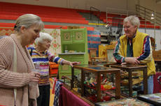 """<div class=""""source"""">KACIE GOODE/The Kentucky Standard</div><div class=""""image-desc"""">Patrons browse booths at Sunday&#039;s Antiques Show at Nelson County High School.</div><div class=""""buy-pic""""><a href=""""/photo_select/94370"""">Buy this photo</a></div>"""