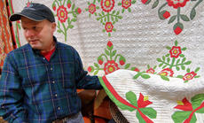 """<div class=""""source"""">KACIE GOODE/The Kentucky Standard</div><div class=""""image-desc"""">Chris Warne of Big Creek Antiques displays a Kentucky Quilt at Sunday&#039;s Antiques Show at Nelson County High School.</div><div class=""""buy-pic""""><a href=""""/photo_select/94374"""">Buy this photo</a></div>"""