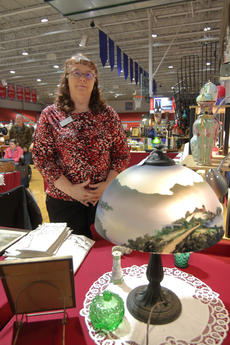 """<div class=""""source"""">KACIE GOODE/The Kentucky Standard</div><div class=""""image-desc"""">Grace Lilly, of Nothing New Antiques, stands beside a lamp that belonged to her aunt and uncle in upstate New York. The piece was one of several for sale at her booth during the Antiques Show at Nelson County High School.</div><div class=""""buy-pic""""><a href=""""/photo_select/94377"""">Buy this photo</a></div>"""