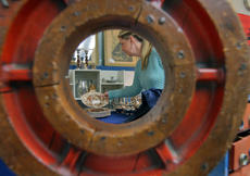 """<div class=""""source"""">KACIE GOODE/The Kentucky Standard</div><div class=""""image-desc"""">A woman browses a booth Sunday afternoon at the Bardstown Antiques Show at Nelson County High School. This year marked 51 years for the show, which lost its founder in February.</div><div class=""""buy-pic""""><a href=""""/photo_select/94371"""">Buy this photo</a></div>"""