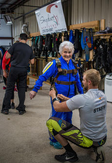"""<div class=""""source"""">KACIE GOODE/The Kentucky Standard</div><div class=""""image-desc"""">Instructor Jim Wade helps Audrey Simek prepare for a skydiving adventure Saturday at Skydive Kentucky in Elizabethtown.</div><div class=""""buy-pic""""><a href=""""/photo_select/105072"""">Buy this photo</a></div>"""